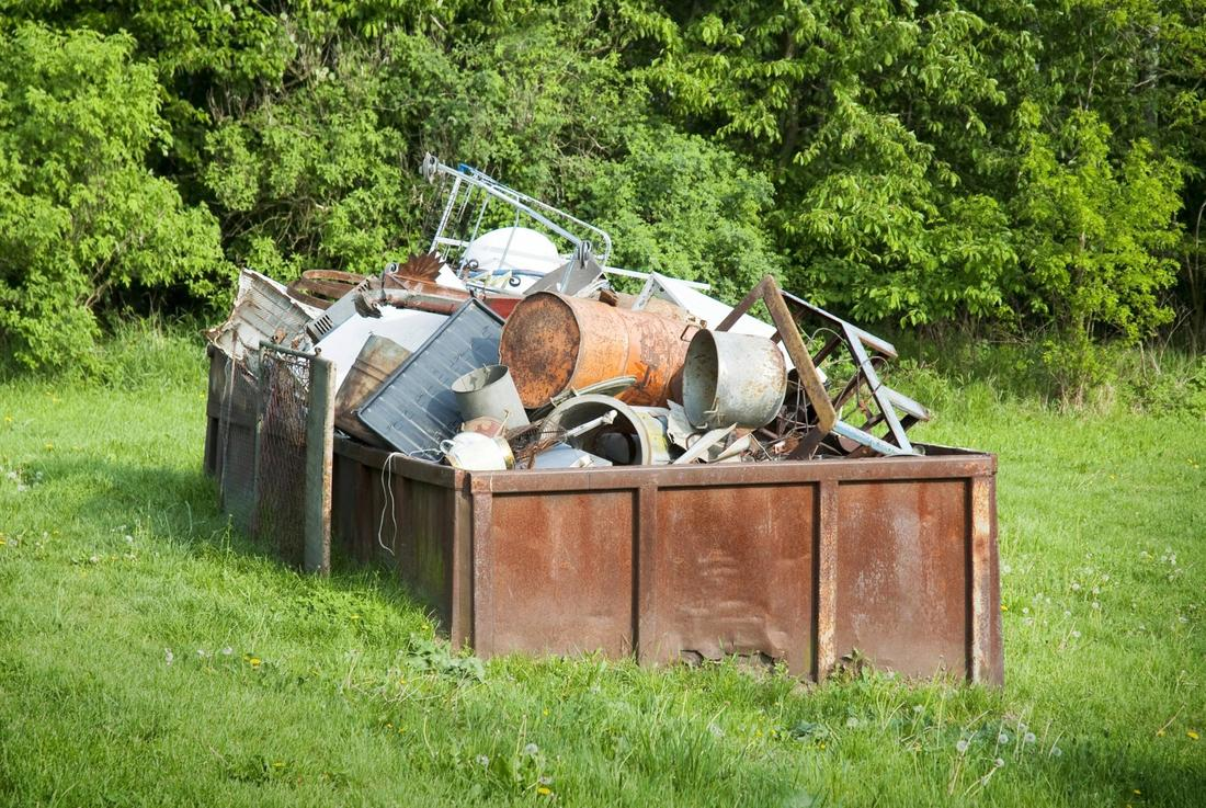 Dumpster with rusty junk